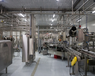 The interior of a dairy plant showing clean equipment ready for use.