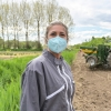 A farmworker wearing a mask.